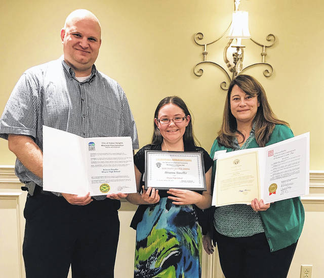 Wayne High School's Brianna Stauffer, center, was named the recipient of 2018 Dayton LaSertoma International Youth Service Award. She is pictured with Wayne Principal Jeffrey Berk and her mother, Tonya.
