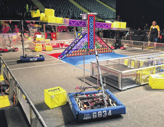 Student-built robots moved cubes around the field during FIRST Robotics Miami Valley Regional competition at the Nutter Center.