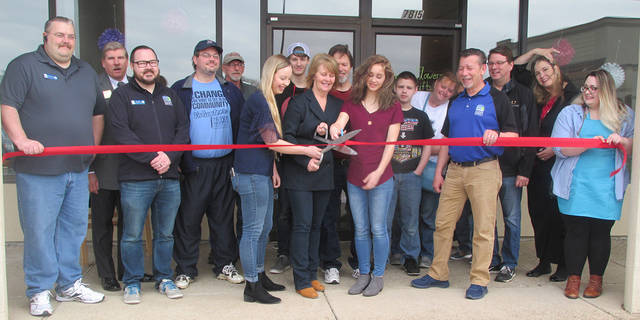 Members of the Huber Heights Chamber of Commerce welcomed Divine Flowers & Gifts with a ribbon cutting ceremony on Saturday. Cutting the ribbon for Divine Flowers & Gifts is, left to right, Marketing Director Taylor Flaugher, Owner Sheri Ward, and Operations Manager Sophia Ward.