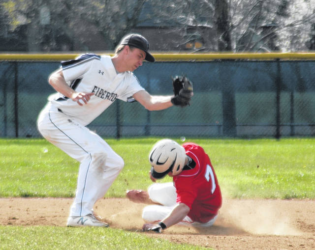 <strong>Kevin Baugh slides in safe after stealing second in the top of the 1<sup>st</sup> inning.</strong>