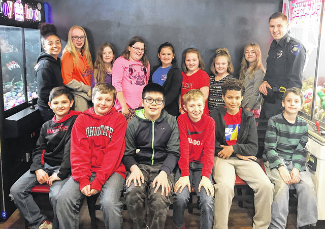 Pictured are the Huber Heights Schools Safety Patrol of the month for April. Back row, left to right, Madison Taylor, Morgyn Rose, Ashley Barlow, Elayna Page, Mackenzie Hay, Parker Pride, Paytan Merris, Jordan Shaner, and Officer Nick Lambert; front row, left to right, Traye Herrington, Logan Krisher, Jake Fernandez, Tyler Knueve, Jayden Flethcher, and Theodore Hood. Not pictured are Brooklyn Walker, Marcus Calhoun, Addison Gearheart, and De'airra Reid.