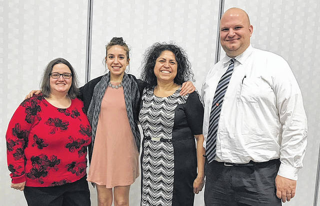 Wayne Senior Rebekah Spence recently was awarded the Franklin B. Walter scholarship from the Montgomery County Education Service Center. Spence, who will attend Ohio State University and study Biomedical Engineering, is pictured left to right with Karen Robles, her mother Maria Spence, and Wayne Principal Jeff Berk.