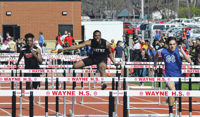 James Page runs in the 100 meter hurdles at the Wayne Invitational.
