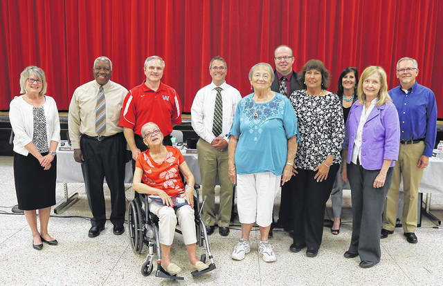 The Huber Heights City Schools recently honored retiring teachers and staff. Pictured left to right are Superintendent Sue Gunnell, Board Member William Harris, Board Member Mark Combs, Board President Mike Miller, Marti Garrett, Board Member Tony Cochran, Pam Spears, Treasurer Gina Helmick, Nancy Thompson, and Board Member Kelly Bledsoe.