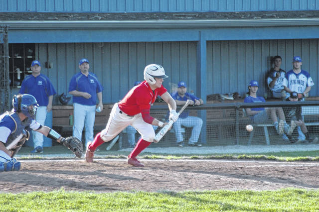 <strong>Kevin Baugh lays down a perfect bunt single in the top of the 7<sup>th</sup> inning at Miamisburg.</strong>
