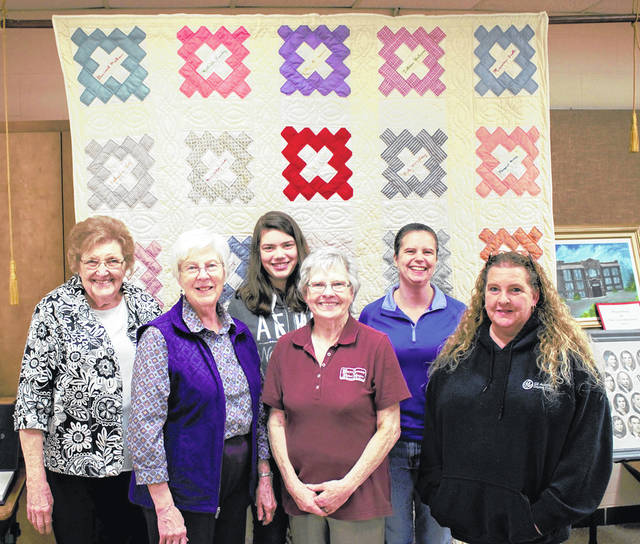 Members of the Wayne Township-Huber Heights Historical Society pose in front of a 90-year old friendship quilt on display at the Society. Pictured front row, left to right, are Judy Shoup Holt, Pat Stephens, Teresa Roberts; back row, Bertie Harbison, Hannah Savard, and Mariann Savard.