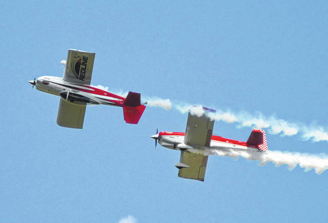 Red Line, whose RV-8 homebuilt airplanes are flown by Ken Rieder and Jon Thocker of Cincinnati, perform a crossover during the 2018 Vectren Dayton Air Show.