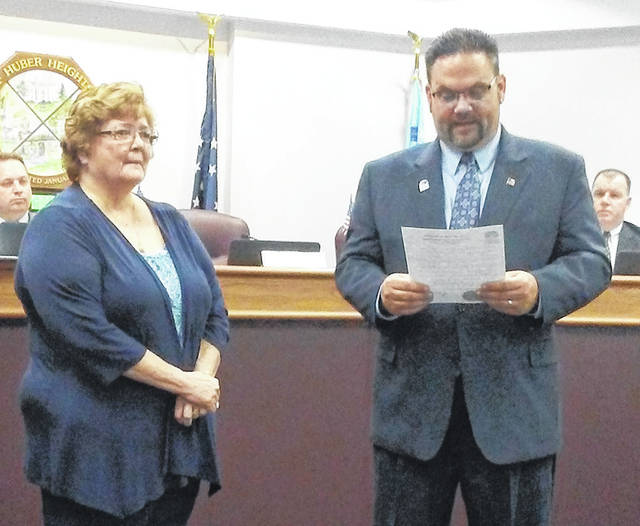 Huber Heights Mayor Jeff Gore presented a proclamation to Sandy Brankamp, wife of Jack Brankamp who died on May 18. Flags in the city were lowered to half-staff on Tuesday, June 12 to honor Brankamp.