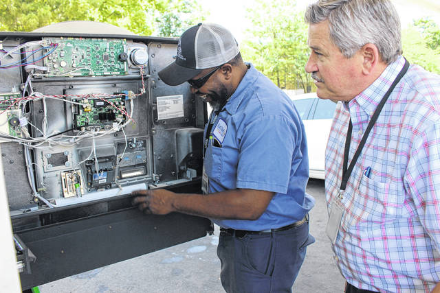 <strong>Karl Keith and Joe Harris Inspect a pump during FBI Skimmer Sweep.</strong>