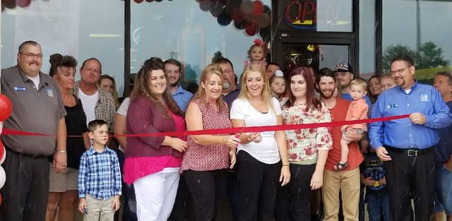 A ribbon cutting was held at Perfections Beauty College on Waynetown Blvd. in Hube Heights on Saturday.