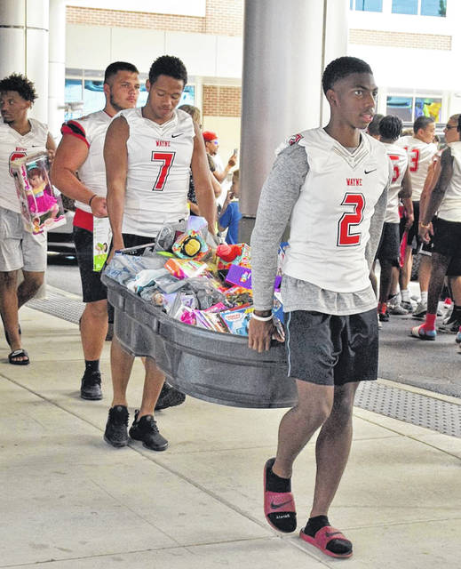 The Wayne football is building team unity and giving back to the community leading up to the kickoff of the 2018 season. The team stayed at Camp Chautauqua July 28-29 for some team bonding. While coming home on the 29th, the team stopped by Dayton Children's Hospital to drop off toys collected by Engage CC for Hayden's Helping Hands. Hayden's Helping Hands provides molding kits to families at no cost so they can have their child's hand or feet put into a mold should they go through the tragedy of losing their child.