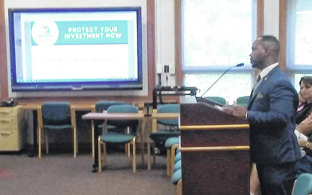 Montgomery County Recorder Brandon McClain explains the county's fraud alert notification program and veteran identification card program to Huber Heights City Council Monday night.