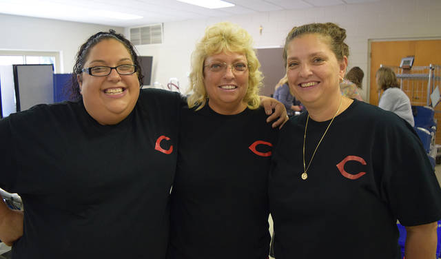 Sisters Ashley Daniel-Phillips, Tina Daniel, and Lisa Ritchey celebrated the success of the sixth annual Ed Daniel Memorial Blood Drive held at St. Matthew Lutheran Church in Huber Heights.