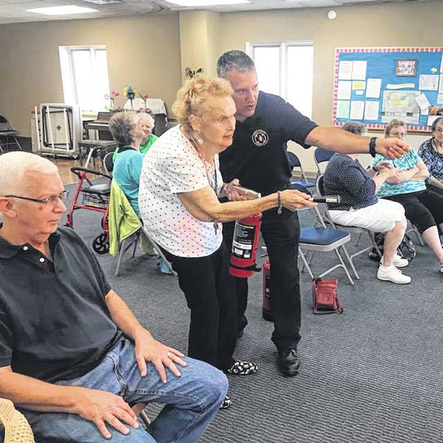 Huber Heights Fire Division Lt. John Russell visited the Huber Heights Senior Center last week to demonstrate the proper use of a fire extinguisher and to demonstrate CPR. For more information on fire prevention programs, contact the fire department at (937) 233-1564.