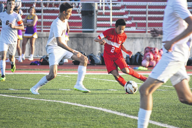<strong>Justin Doan (2) tries to maneuver past Butler defender Anthony Kowler (17).</strong>