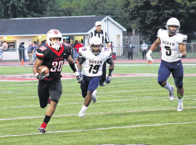 <strong>Running back Devin Nelson breaks loose for a big gain against Archbishop Hoban.</strong>
