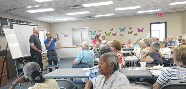 """Huber Heights Senior Center members received information from chiropractor, Dr Peltier, at a Lunch and Learn. Senior center president, Jim Boggs, volunteered to be the """"patient"""" for demonstration purposes."""