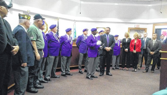 Members of the Military Order of the Purple Heart Department of Ohio and local veterans' groups were on hand as Huber Heights Mayor Jeff Gore received the city's designation as a Purple Heart City on Monday, Sept. 24.