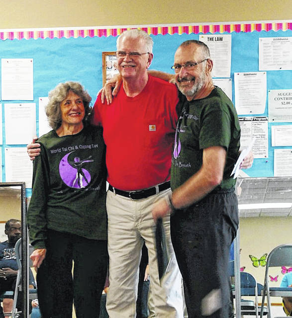 Sue and Bill McCabe, Tai Chi and Golden Qi instructors, were presented with the Special Senior Award by the Huber Heights Senior Center president, Jim Boggs.