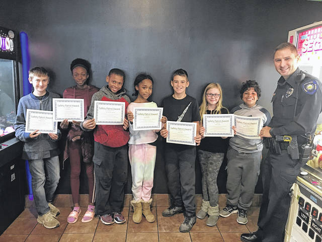 Congratulations to the following students for being recognized as the October Safety Patrol Students of the Month. The Huber Heights Police give the students certificates, lunch with Police Officers, and prizes. Left to right are Phillip Gruen and Cai Bowers from Charles Huber Elementary, Key'Shawn Garrett and Laila Woods from Wright Brothers Elementary, Joey Tobe and Carla Swift from Monticello Elementary, Jaedyn Smith from Valley Forge Elementary, and Officer Nick Lambert from the Huber Heights Police Division.