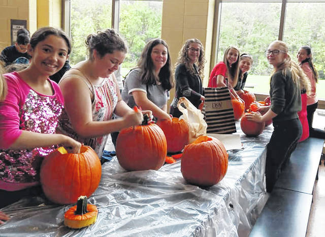 The National Junior Honor Society, Student Council, and Spanish Club members at Weisenborn Junior High recently came together to carve pumpkins to decorate the school's exterior.