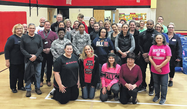 The annual Shoes for the Shoeless at Rushmore Elementary School was held on Monday, Nov. 19. Over 300 pair of shoes and over 600 pair of socks were given away at the event by these volunteers.