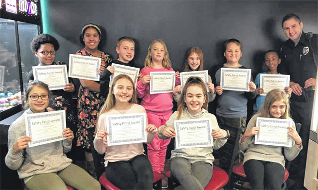 The November Safety Patrolers of the Month are pictured left to right starting in the back) Jalyen Gaddis and Ana Gibson from Charles H Huber Elementary, Dylan Day and Alexis Finke from Wright Brothers Elementary, Ella Joseph and Wesley Carr from Monticello Elementary, Rico McCarthy, Serenity Osgood, Ellie McElroy, and Madison Wynkoop from Rushmore Elementary, Kayla Anderson from Valley Forge Elementary, with officer Nick Lambert Huber Heights Police Officer.