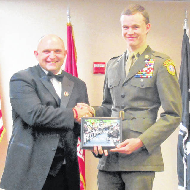 Unit Commander J. Keagan Miller presents YM/Gunnery Sergeant John Sollinger with Young Marine of the Year Award.