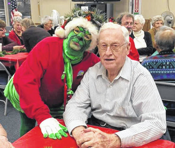The Huber Heights Senior Center enjoyed a visit from the Grinch. Pictured is Ned Yaney with Andi Otto as the Grinch