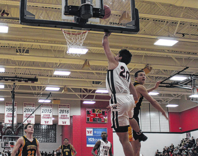 <strong>Bobby Cole banks a shot in off the glass against Centerville.</strong>