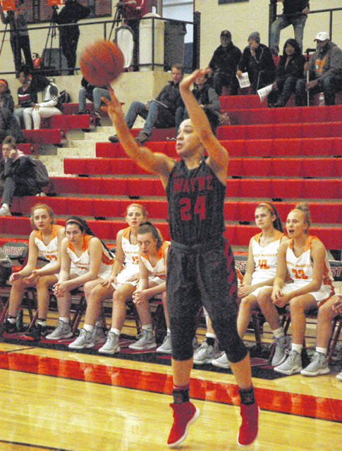 <strong>Jaida Wolfork buries a 3-pointer during the second quarter vs. Mercy McAuley.</strong>