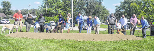 In this file photo, members of the Huber Heights City Council and city staff break grround on a dog park at Menlo Park. Dog park and other amenities desired by residents are some of the recommended upgrades as part of the Huber Heights Parks and Recreatio Master Plan Phase II presented to council on Tuesday night.
