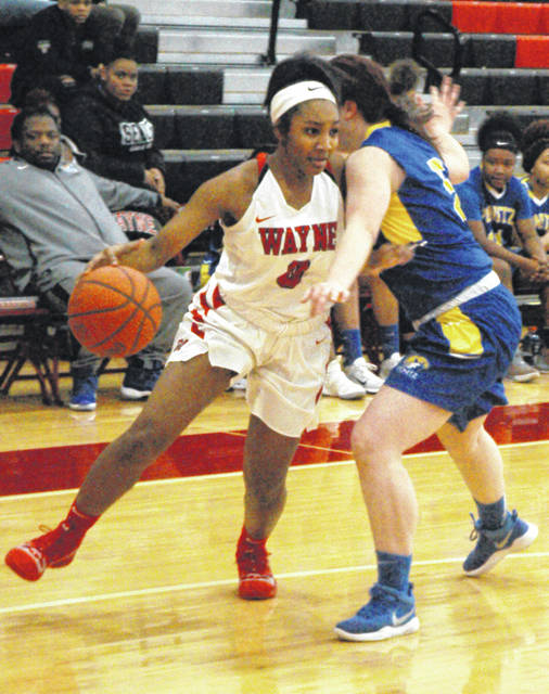 <strong>Ariyah Long tries to dribble inside past Kyla King.</strong>