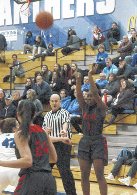 <strong>Charity Miller scores one of her four 3-pointers of the night against Springboro to end up as Wayne's leading scorer with 13 points.</strong>