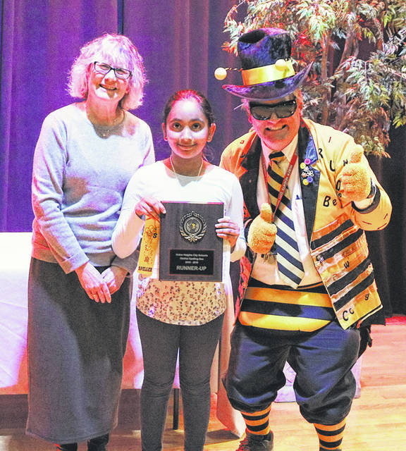 Ziya Patel placed second in the Huber Heights City Schools Spelling Bee. She is pictured with Superintendent Sue Gunnell and School Psychologist Curt Hefner.