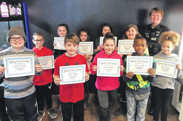 The students chosen as Safety Patrollers of the Month for January 2019 are pictured from left to right back row from Charles H. Huber Elementary Carson Limberg, Julieanna Biggs. From Wright Brothers Elememtary Andi Reid Sarah Teague. From Monticello Elementary Gabriella Fitch. School Resource Officer Shoemaker. Front row left to right from Rushmore Elementary Colton Sturgill and Jacob Detty. From Valley Forge Elementary Abigail Hatfield and Christian Howard and from Monticello Elementary Katie Leggs. Not pictured from Charles H. Huber Elementary is Hanna Todd.