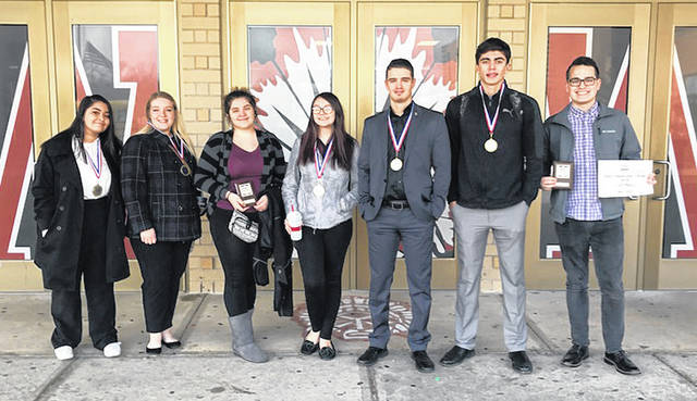 Pictured left to right are Wayne High School Business Professionals of America membes Tacenanna Zeleya, Faith Bastress, Daisy Gibb, Destiny Wagoner, Caleb Pequignot, Bobby Cole and Matt Stuart.