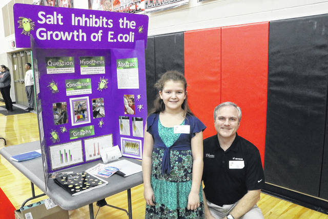 Catherine Zbinden and HHCS Board Member Mark Combs with Catherine's project, Salt Inhibits The Growth Of E. Coli.