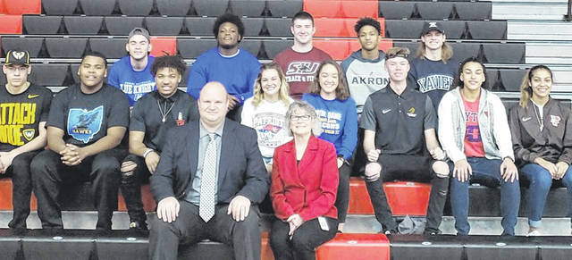 Pictured behind Wayne Principal Jeffrey Berk and Huber Heights City Schools Superintendent Sue Gunnell are, middle row, left to right Brian Hill, Alexander Ealy, Steven Victoria, Hunter Houck, Armani Dortch, Trevor Hawley, Destiny Bohanon, Olivia Trice; back row, left to right, Trevor Bom, Ruchaunn Long, Dylan Beaird, Zarik Brown, and Lucas Houk.