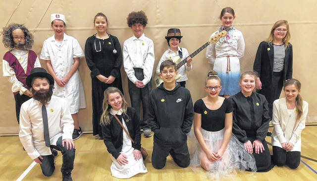 6th grade SOAR students from Huber Heights Schools held their Night of the Notables by dressing in character while family and friends asked questions to determine their identity. They picked historical figures including Stan Lee, Elizabeth Blackwell, Marie Curie, Usain Bolt, and Shigeru Miyamoto. Students also had a treasure box with journal entries, pictures, awards, and souvenirs to represent their Notable.