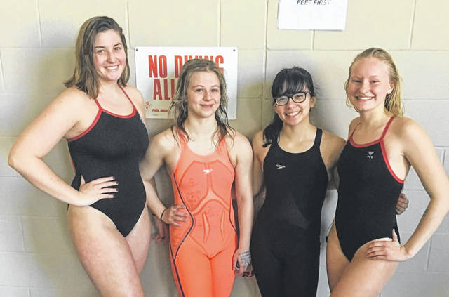 <strong>The record setting 200 free relay team left to right: Meghan Posey, Kaitlyn Riegle, Morgan Fernandez, and Haley Geiger.</strong>