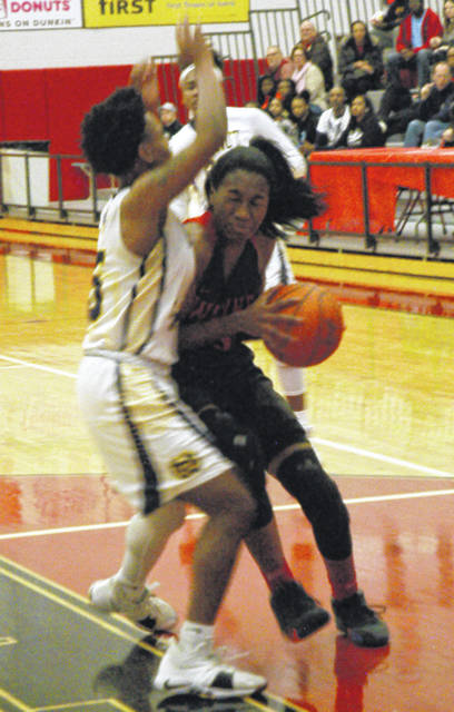 <strong>Aubryanna Hall fights her way past Walnut Hills defender Darian Burgin.</strong>