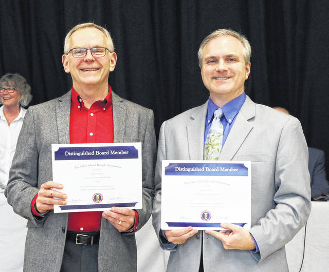 Huber Heights Board of Education members Kelly Bledsoe (left) and Mark Combs (right) were honored by the Ohio School Board Association for 10 years of board service.