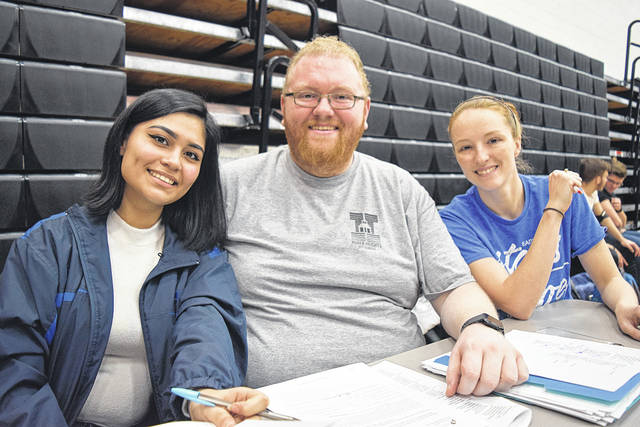 Wayne National Honor Society Member Karla Vallejo and NHS Advisors A.J. Ricker and Jen Ostendorf checked in donors during the Wayne High School blood drive on Feb. 25.