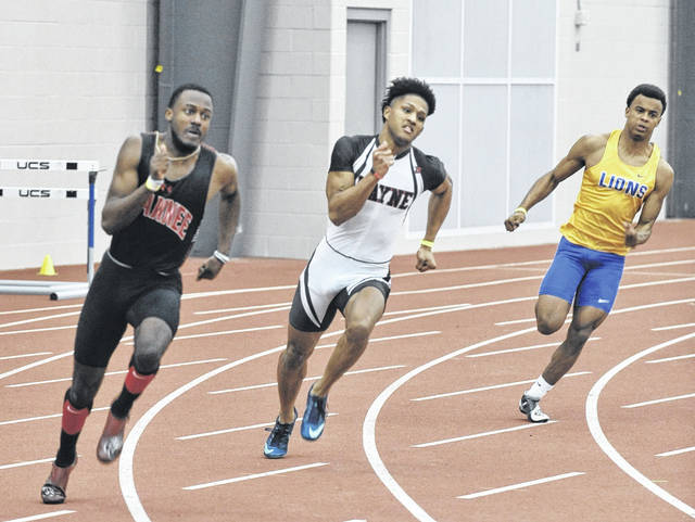 <strong>Senior Zarik Brown (center) was a two-time state champion, winning the 400 meter dash (48.77) and 200 meter dash (21.54). Brown also took third in the 60 meter dash, running 6.84 seconds. All three marks were new Wayne High School records.</strong>