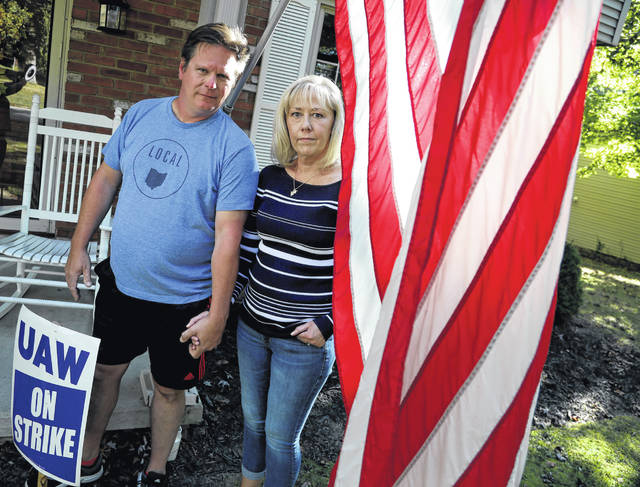 Mike and Sara Yakim in front of their house in Lordstown, Ohio, on Wednesday. (Eric Seals/Detroit Free Press/TNS)
