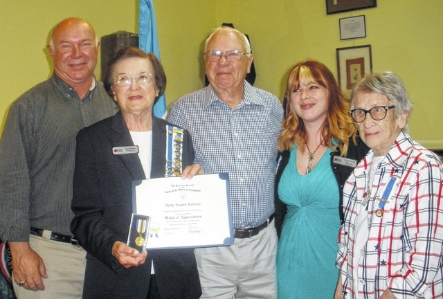 Urbana Chapter Registrar Betty Driever received The National Society of the Sons of the American Revolution Medal of Appreciation for outstanding genealogical assistance. Mary Pollock's son, Col. Robert D. Pollock, president of the District of Columbia State Society of SAR, nominated Betty. Mary's granddaughter Lexi made the presentation. From left are Lou Driever Jr., Betty Driever, Lou Driever, Lexi Pollock and Mary Pollock.