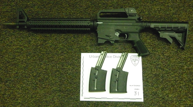 Urbana police recovered a stolen .22 caliber AR-15 semi-automatic rifle during a raid on a Railroad Street residence Saturday. Police also recovered drugs, drug paraphernalia items and cash from the residence and charged a man with three felony charges.