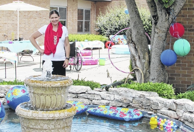 "Vancrest of Urbana's new administrator, Stephanie Tozbikian, says she looks forward to meeting the community. Here she celebrates a ""pool and beach"" event with Vancrest residents earlier this month."