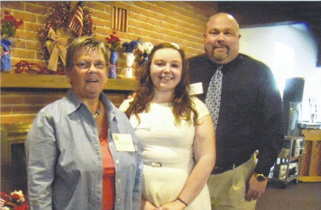 Winner of the Champaign County Retired Teachers Association Scholarship, Rachel Ebert, center, was recognized at the June meeting of the group. On the left is Pat Detwiler, president, and at right is her father, Richard Ebert. She graduated with honors from Urbana High School and will major in Music Education at Wright State University in the fall.